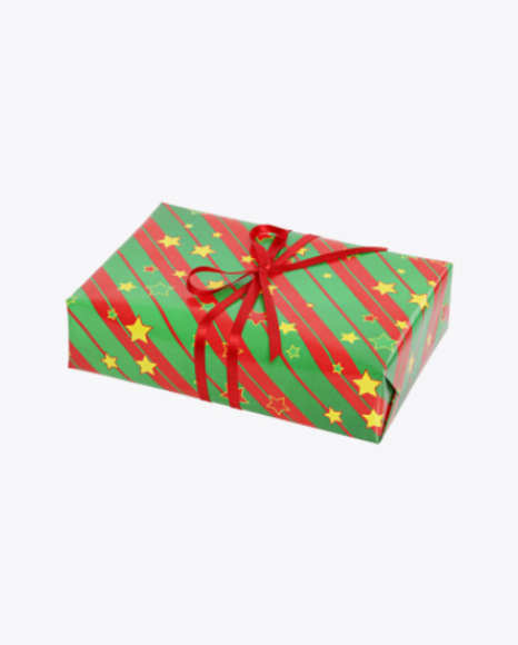 Christmas Gift Box Wrapped in Green Paper with Stripes and Stars Pattern