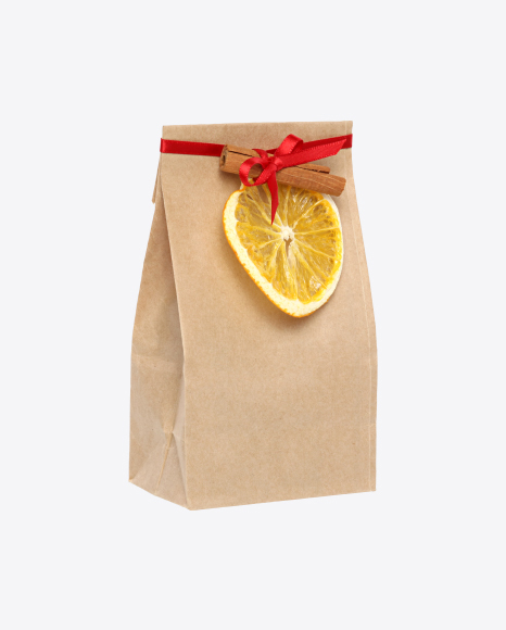 Christmas Gift in Paper Bag with Cinnamon and Dried Orange Slice