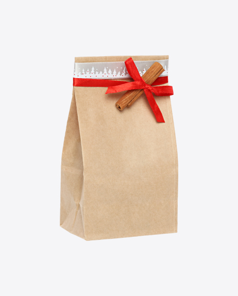 Christmas Gift in Paper Bag with Cinnamon Stick