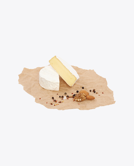 Camembert Halves with Nuts and Spices on Craft Paper