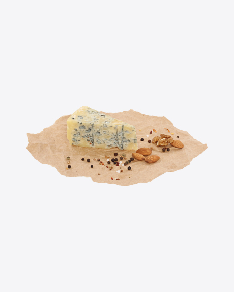Blue Cheese Triangular Slice with Nuts and Spices on Craft Paper