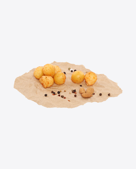 Smoked Cheese Balls in Paprika with Nuts and Spices on Craft Paper