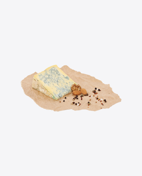 Blue Cheese Triangle with Nuts and Spices on Craft Paper