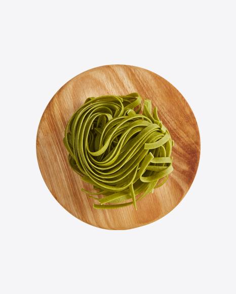 Basil Tagliatelle Pasta on Wooden Cutting Board