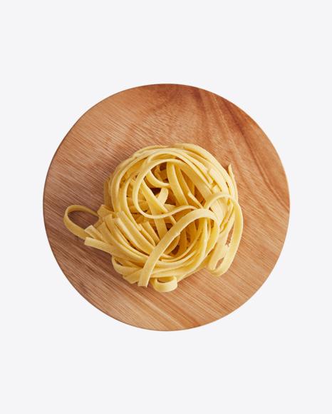 Tagliatelle Pasta on Wooden Cutting Board