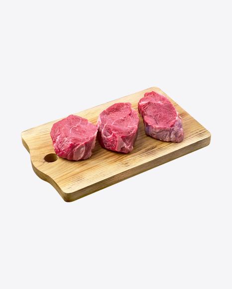 Raw Steaks on Wooden Board