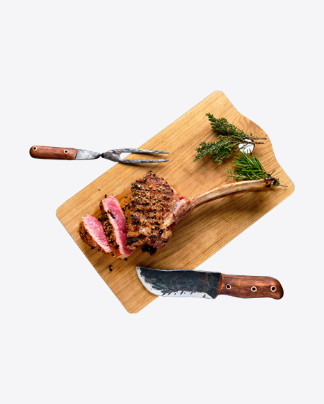 Tomahawk Steak w/ Spices, Fork & Knife on Wooden Board