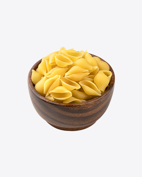 Raw Conchiglie Rigate Pasta in Wooden Bowl