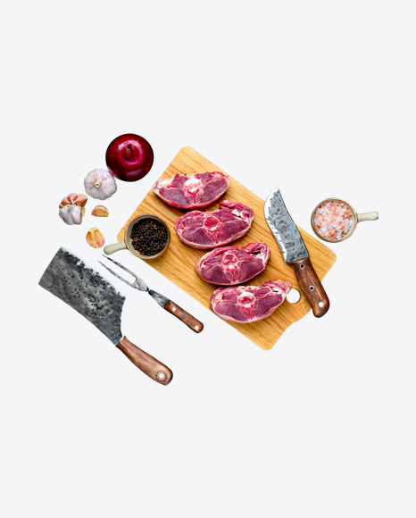 Raw Meat Pieces w/ Onion, Garlic, Spices & Tabelware on Wooden Board