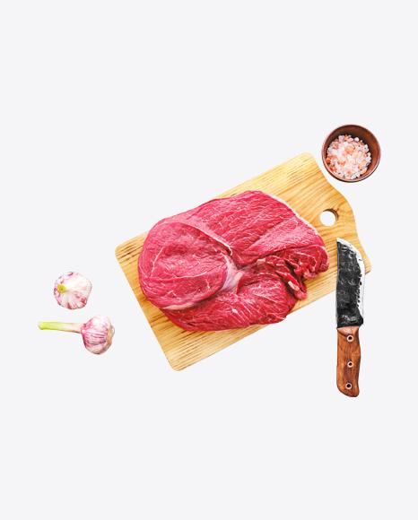 Raw Red Meat Piece w/ Salt & Garlic on Wooden Board